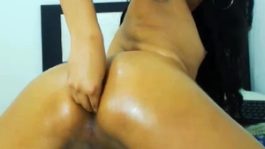 Shemale oiled fingering on live cam