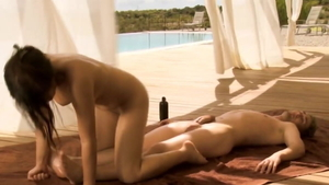 Brunette oily massage outdoors