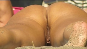 Pussy eating at the beach accompanied by naked cougar