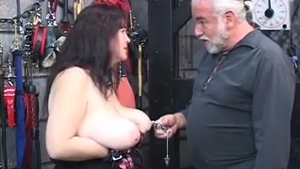 Large boobs MILF enjoys sex scene in clamps