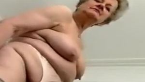 Solo naughty granny striptease