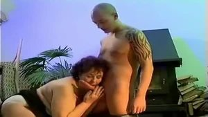 Blowjobs in company with huge granny