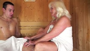 Cumshot in the sauna next to hairy stepmom
